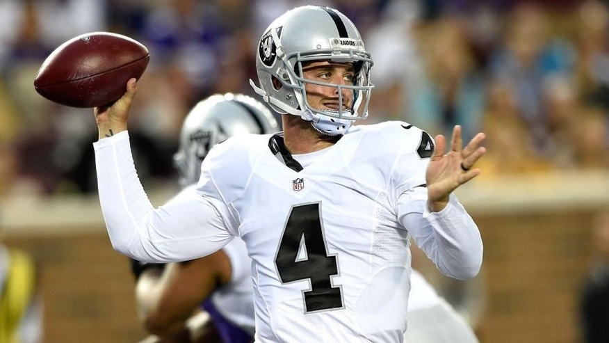 MINNEAPOLIS, MN - AUGUST 22: Derek Carr #4 of the Oakland Raiders passes the ball during the first quarter of the preseason game against the Minnesota Vikings on August 22, 2015 at TCF Bank Stadium in Minneapolis, Minnesota. (Photo by Hannah Foslien/Getty Images)