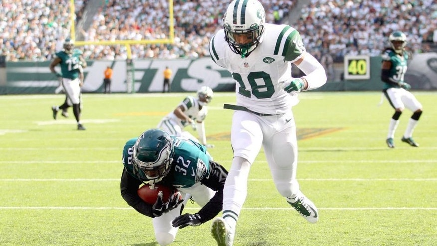 Sep 27, 2015; East Rutherford, NJ, USA; Philadelphia Eagles defensive back Eric Rowe (32) intercepts a pass intended for New York Jets wide receiver Devin Smith (19) and rolls into the end zone for a touchback during the third quarter at MetLife Stadium. Mandatory Credit: Brad Penner-USA TODAY Sports