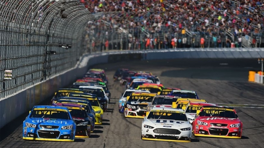 LOUDON, NH - SEPTEMBER 27: Kevin Harvick, driver of the #4 Ditech Chevrolet, and Brad Keselowski, driver of the #2 Miller Lite Ford, lead the field to a restart during the NASCAR Sprint Cup Series SYLVANIA 300 at New Hampshire Motor Speedway on September 27, 2015 in Loudon, New Hampshire. (Photo by Jared C. Tilton/Getty Images)