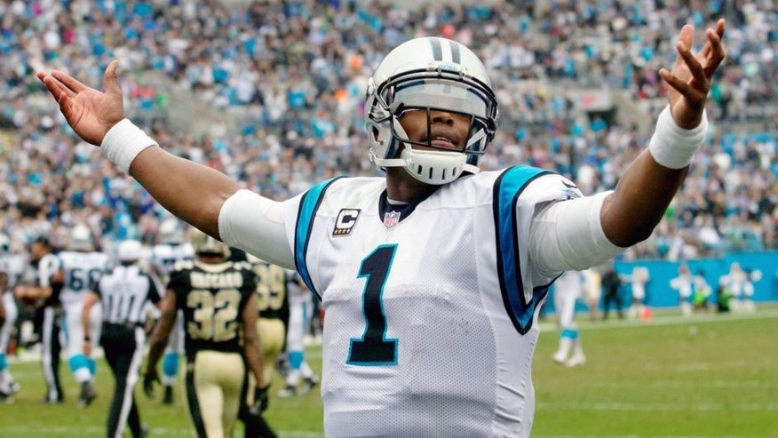 Sep 27, 2015; Charlotte, NC, USA; Carolina Panthers quarterback Cam Newton (1) celebrates after a touchdown during the fourth quarter against the New Orleans Saints at Bank of America Stadium. Carolina defeated the Saints 27-22. Mandatory Credit: Jeremy Brevard-USA TODAY Sports