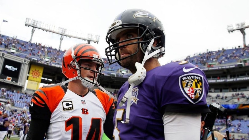 BALTIMORE, MD - SEPTEMBER 27: Quarterback Joe Flacco #5 of the Baltimore Ravens talks with quarterback Andy Dalton #14 of the Cincinnati Bengals after the Cincinnati Bengals defeated the Baltimore Ravens 28-24 at M&T Bank Stadium on September 27, 2015 in Baltimore, Maryland. (Photo by Rob Carr/Getty Images)