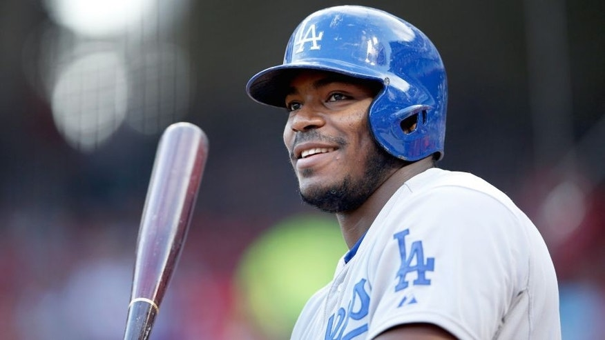 CINCINNATI, OH - AUGUST 26: Yasiel Puig #66 of the Los Angeles Dodgers looks on while waiting to bat against the Cincinnati Reds during the game at Great American Ball Park on August 26, 2015 in Cincinnati, Ohio. The Dodgers defeated the Reds 7-4. (Photo by Joe Robbins/Getty Images)