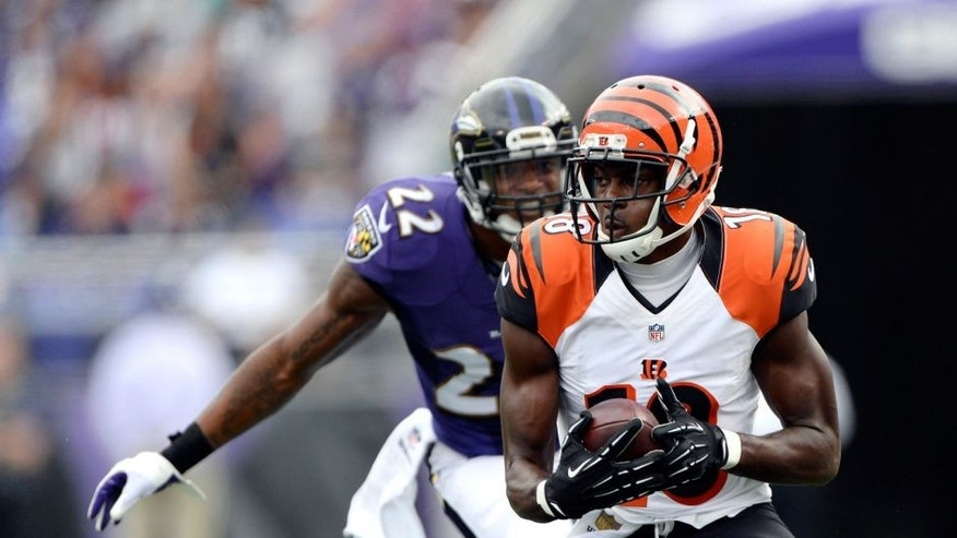 Sep 27, 2015; Baltimore, MD, USA; Cincinnati Bengals wide receiver A.J. Green (18) runs after the catch as Baltimore Ravens cornerback Jimmy Smith (22) defends during the second quarter at M&T Bank Stadium. Mandatory Credit: Tommy Gilligan-USA TODAY Sports
