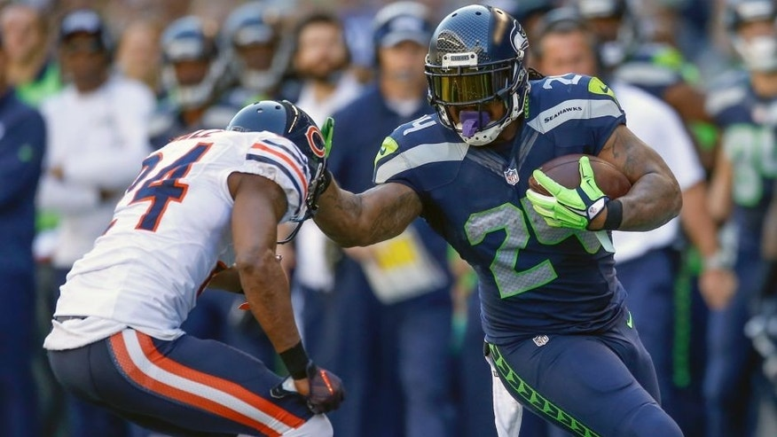 SEATTLE, WA - SEPTEMBER 27: Running back Marshawn Lynch #24 of the Seattle Seahawks rushes against defensive back Alan Ball #24 of the Chicago Bears at CenturyLink Field on September 27, 2015 in Seattle, Washington. (Photo by Otto Greule Jr/Getty Images)