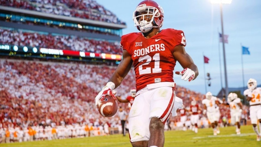Sep 13, 2014; Norman, OK, USA; Oklahoma Sooners running back Keith Ford (21) scores a touchdown during the game against the Tennessee Volunteers at Gaylord Family - Oklahoma Memorial Stadium. Mandatory Credit: Kevin Jairaj-USA TODAY Sports