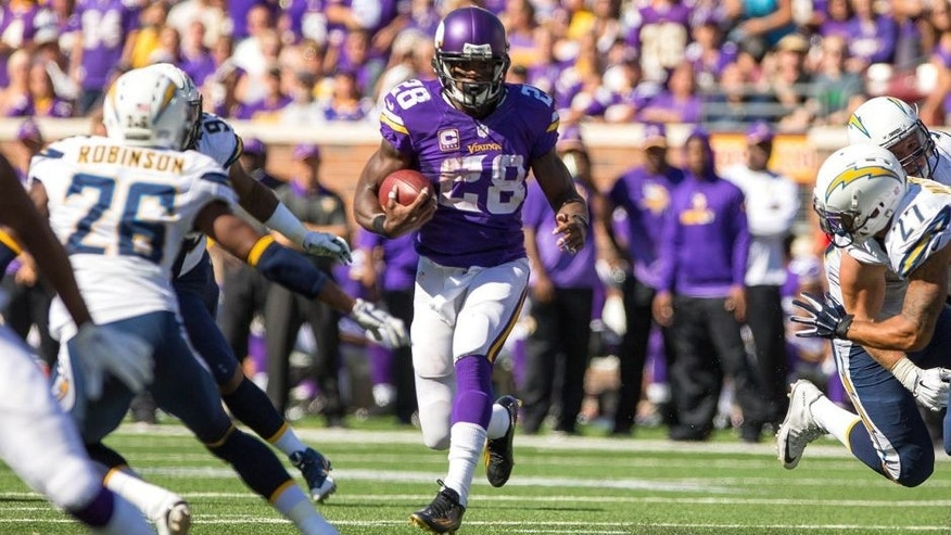 Sep 27, 2015; Minneapolis, MN, USA; Minnesota Vikings running back Adrian Peterson (28) runs in the third quarter against the San Diego Chargers at TCF Bank Stadium. The Minnesota Vikings beat the San Diego Chargers 31-14. Mandatory Credit: Brad Rempel-USA TODAY Sports
