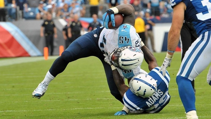 Sep 27, 2015; Nashville, TN, USA; Tennessee Titans fullback Jalston Fowler (45) is tackled by Indianapolis Colts strong safety Mike Adams (29) to prevent the tie score on the two point conversion attempt during the second half at Nissan Stadium. Indianapolis won 35-33. Mandatory Credit: Jim Brown-USA TODAY Sports