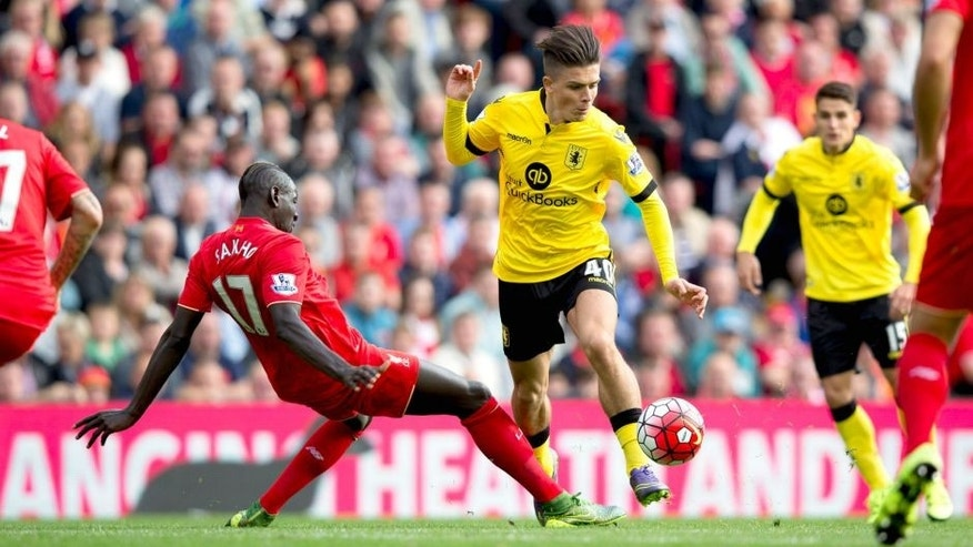 LIVERPOOL, ENGLAND - SEPTEMBER 26 : Jack Grealish of Aston Villa is challenged by Mamadou Sakho of Liverpool during the Barclays Premier League match between Liverpool and Aston Villa at Anfield on September 26, 2015 in Leicester, England. (Photo by Neville Williams/Aston Villa FC via Getty Images)
