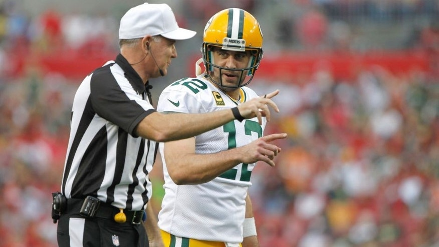 Dec 21, 2014; Tampa, FL, USA; Green Bay Packers quarterback Aaron Rodgers (12) talks with the referee against the Tampa Bay Buccaneers during the second half at Raymond James Stadium. Green Bay Packers defeated the Tampa Bay Buccaneers 20-3. Mandatory Credit: Kim Klement-USA TODAY Sports