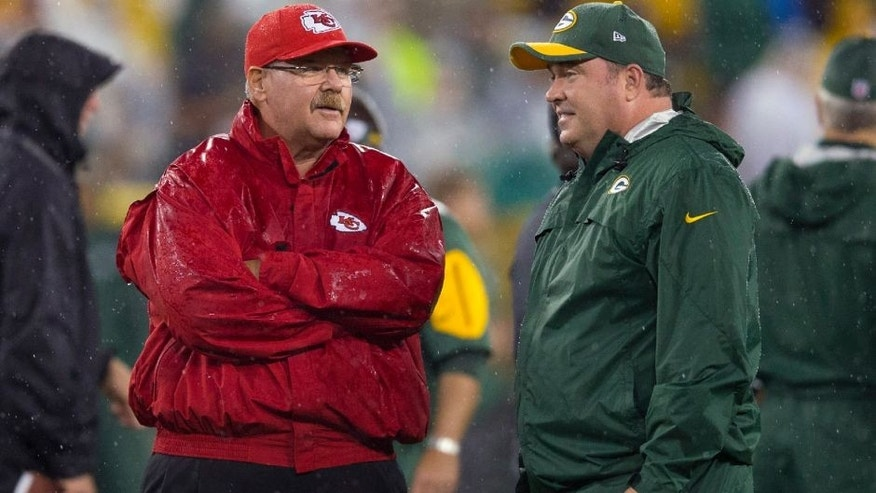 <p>Sep 28, 2015; Green Bay, WI, USA; Kansas City Chiefs head coach Andy Reid talks with Green Bay Packers head coach Mike McCarthy prior to the game at Lambeau Field. Mandatory Credit: Jeff Hanisch-USA TODAY Sports</p>
