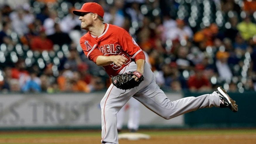 <p>Los Angeles Angels closer Joe Smith follows through on a pitch against the Houston Astros in the ninth inning of a baseball game on Saturday, April 5, 2014, in Houston. The Angels won 5-1. (AP Photo/Pat Sullivan)</p>