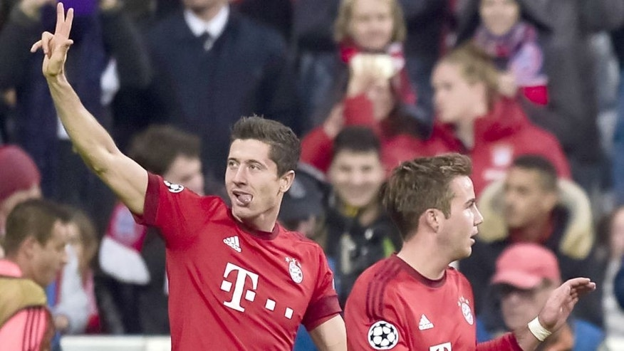 Bayern Munich's Polnish striker Robert Lewandowski (L) celebartes after scoring the fifth goal during the Group F, first-leg UEFA Champions League football match FC Bayern Munich vs GNK Dinamo Zagreb in Munich, on September 29, 2015. AFP PHOTO / GUENTER SCHIFFMANN (Photo credit should read GUENTER SCHIFFMANN/AFP/Getty Images)
