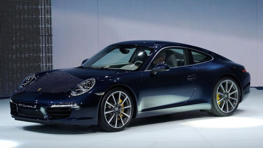 FRANKFURT AM MAIN, GERMANY - SEPTEMBER 13: Porsche presents the new Porsche 911 during the press days at the IAA Frankfurt Auto Show on September 13, 2011 in Frankfurt am Main, Germany. The IAA will be open to the public from September 17 through September 25.(Photo by Thorsten Wagner/Getty Images)