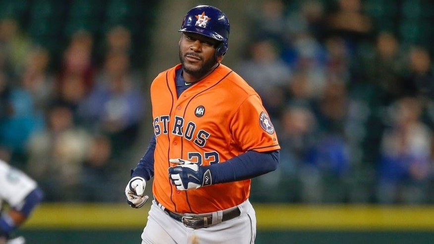 SEATTLE, WA - SEPTEMBER 28: Chris Carter #23 of the Houston Astros rounds the bases after hitting a solo home run in the seventh inning against the Seattle Mariners at Safeco Field on September 28, 2015 in Seattle, Washington. (Photo by Otto Greule Jr/Getty Images)