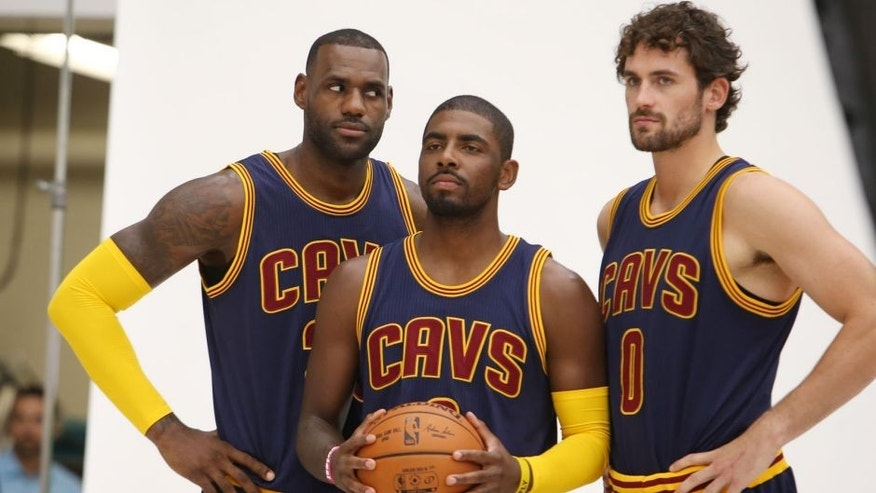 Cleveland Cavaliers' Lebron James, left, Kyrie Irving, center, and Kevin Love pose for a portrait during the NBA team's media day, Monday, Sept. 28, 2015, in Independence, Ohio. (AP Photo/Ron Schwane)