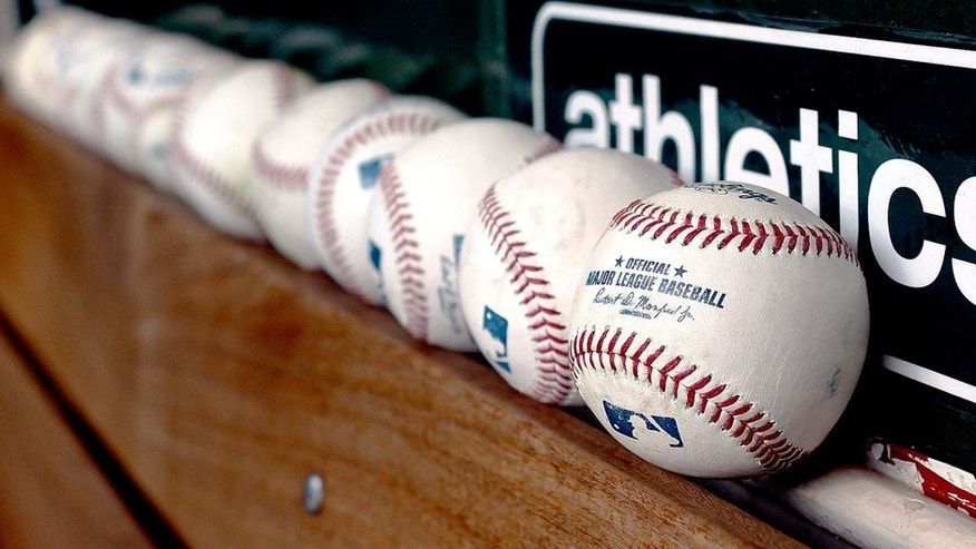 OAKLAND, CA - MAY 11: A detailed view of Major League Baseballs sits in the dugout prior to the game between the Boston Red Sox and Oakland Athletics at O.co Coliseum on May 11, 2015 in Oakland, California. (Photo by Thearon W. Henderson/Getty Images)