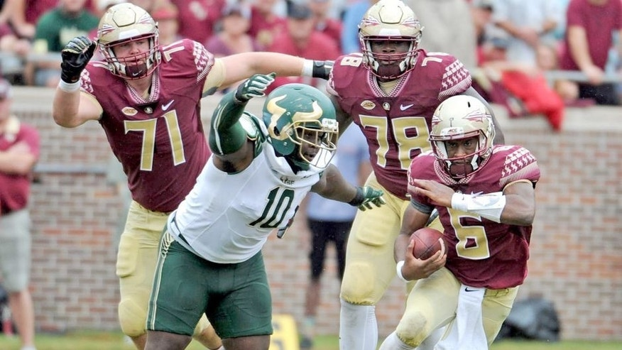 Sep 12, 2015; Tallahassee, FL, USA; Florida State Seminoles quarterback Everett Golson (6) runs the ball as he is pursued by University of South Florida Bulls defensive tackle Deadrin Senat (10) during the first half of the game at Doak Campbell Stadium. Mandatory Credit: Melina Vastola-USA TODAY Sports