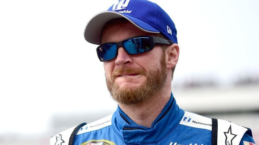 LOUDON, NH - SEPTEMBER 25: Dale Earnhardt Jr., driver of the #88 Nationwide Chevrolet, stands in the garage area during practice for the NASCAR Sprint Cup Series Sylvania 300 at New Hampshire Motor Speedway on September 25, 2015 in Loudon, New Hampshire. (Photo by Jared C. Tilton/Getty Images)