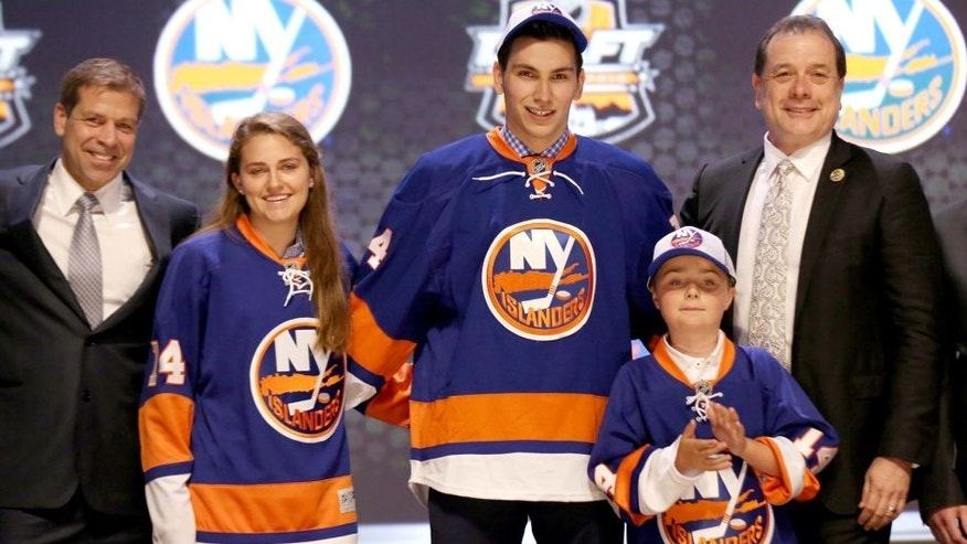 Jun 27, 2014; Philadelphia, PA, USA; Michael Dal Colle poses for a photo after being selected as the number five overall pick to the New York Islanders in the first round of the 2014 NHL Draft at Wells Fargo Center. Mandatory Credit: Bill Streicher-USA TODAY Sports