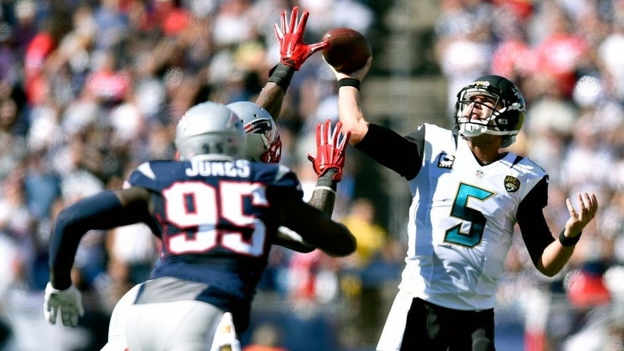 Sep 27, 2015; Foxborough, MA, USA; Jacksonville Jaguars quarterback Blake Bortles (5) passes as New England Patriots defensive end Chandler Jones (95) defends in the first half at Gillette Stadium. New England defeated Jacksonville 51-17. Mandatory Credit: James Lang-USA TODAY Sports