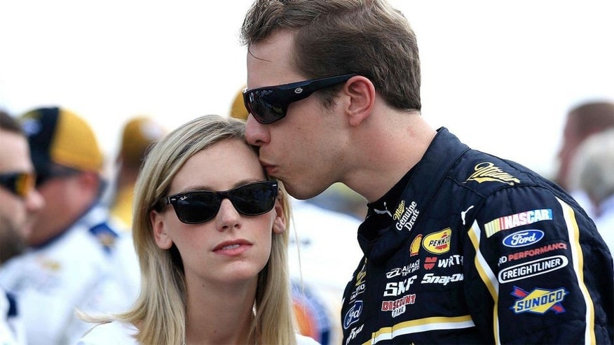 Aug 16, 2015; Brooklyn, MI, USA; NASCAR Sprint Cup Series driver Brad Keselowski kisses girlfriend Paige White prior to the Pure Michigan 400 at Michigan International Speedway. Mandatory Credit: Andrew Weber-USA TODAY Sports