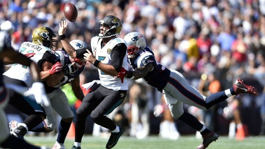 <p>Sep 27, 2015; Foxborough, MA, USA; Jacksonville Jaguars quarterback Blake Bortles (5) fumbles the ball forward as he is hit by New England Patriots outside linebacker Jamie Collins (91) in the second quarter at Gillette Stadium. Mandatory Credit: James Lang-USA TODAY Sports</p>
