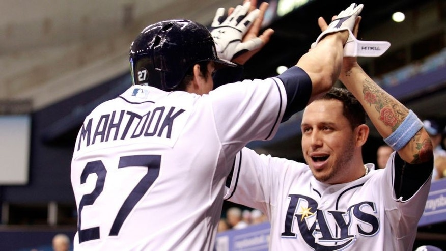Sep 29, 2015; St. Petersburg, FL, USA; Tampa Bay Rays center fielder Mikie Mahtook (27) is congratulated by shortstop Asdrubal Cabrera (13) as he hits a solo home run during the third inning against the Miami Marlins at Tropicana Field. Mandatory Credit: Kim Klement-USA TODAY Sports