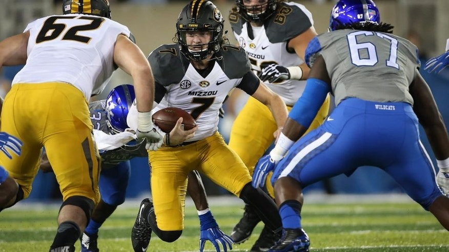 Missouri quarterback Maty Mauk scrambles for an opening during the first half of an NCAA college football game against Kentucky, Saturday, Sept. 26, 2015, in Lexington, Ky. (AP Photo/David Stephenson)