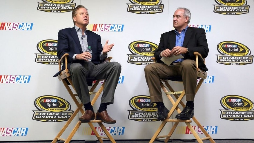 HOMESTEAD, FL - NOVEMBER 14: Brian France (L), CEO and chairman of NASCAR, and NASCAR chief communications officer Brett Jewkes attend a press conference prior to practice for the NASCAR Nationwide Series Ford EcoBoost 300 at Homestead-Miami Speedway on November 14, 2014 in Homestead, Florida. (Photo by Todd Warshaw/Getty Images for NASCAR)
