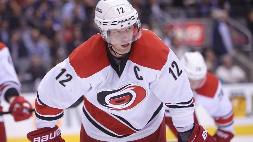 Oct 17, 2013; Toronto, Ontario, CAN; Carolina Hurricanes center Eric Staal (12) before a face-off against the Toronto Maple Leafs at the Air Canada Centre. The Hurricanes beat the Maple Leafs 3-2. Mandatory Credit: Tom Szczerbowski-USA TODAY Sports