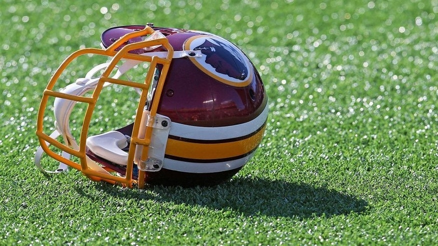 Nov 2, 2014; Minneapolis, MN, USA; Detailed view of a Washington Redskins helmet on the field prior to the game against the Minnesota Vikings at TCF Bank Stadium. Mandatory Credit: Brace Hemmelgarn-USA TODAY Sports