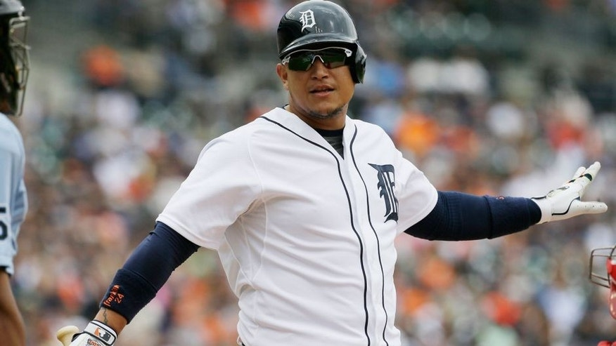 Detroit Tigers' Miguel Cabrera objects to a strike with umpire C.B. Bucknor during the seventh inning of a baseball game aLos Angeles Angels, Thursday, Aug. 27, 2015, in Detroit. (AP Photo/Carlos Osorio)