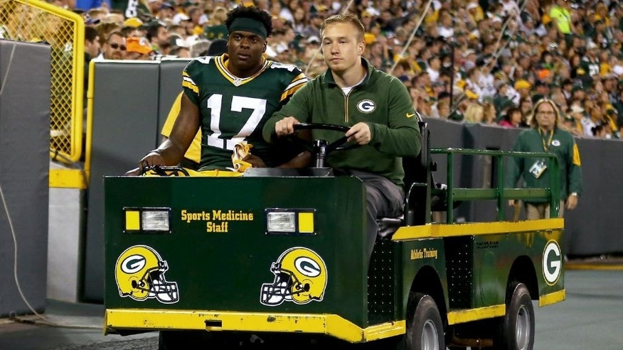 GREEN BAY, WI - SEPTEMBER 20: Davante Adams #17 of the Green Bay Packers is assisted off the field after a play against the Seattle Seahawks during their game at Lambeau Field on September 20, 2015 in Green Bay, Wisconsin. (Photo by Maddie Meyer/Getty Images)