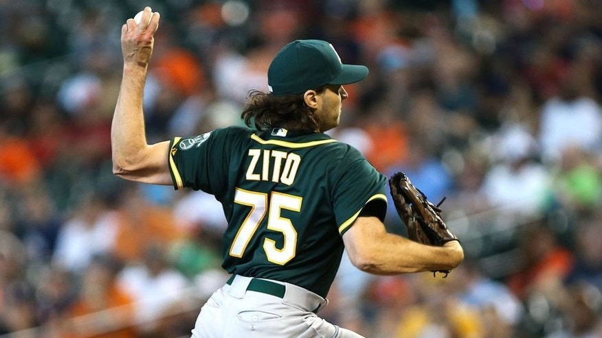 Sep 20, 2015; Houston, TX, USA; Oakland Athletics pitcher Barry Zito (75) pitches in relief during the eighth inning against the Houston Astros at Minute Maid Park. Mandatory Credit: Troy Taormina-USA TODAY Sports