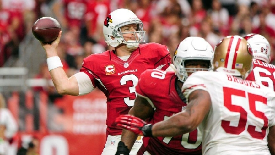 Sep 27, 2015; Glendale, AZ, USA; Arizona Cardinals quarterback Carson Palmer (3) throws during the first half against the San Francisco 49ers at University of Phoenix Stadium. Mandatory Credit: Matt Kartozian-USA TODAY Sports