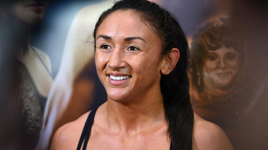 DALLAS, TX - MARCH 11: UFC women's strawweight champion Carla Esparza interacts with media after an open training session for fans and media at the Hilton Anatole Hotel on March 11, 2015 in Dallas, Texas. (Photo by Josh Hedges/Zuffa LLC/Zuffa LLC via Getty Images)