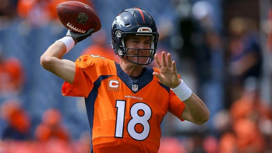 DENVER, CO - SEPTEMBER 13: Quarterback Peyton Manning #18 of the Denver Broncos throws a pass as he warms up before a game against the Baltimore Ravens at Sports Authority Field at Mile High on September 13, 2015 in Denver, Colorado. (Photo by Justin Edmonds/Getty Images)