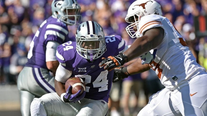 MANHATTAN, KS - OCTOBER 25: Defensive tackle Hassan Ridgeway #98 of the Texas Longhorns tackles running back Charles Jones #24 of the Kansas State Wildcats for a loss during the first half on October 25, 2014 at Bill Snyder Family Stadium in Manhattan, Kansas. (Photo by Peter G. Aiken/Getty Images)