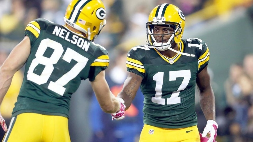 GREEN BAY, WI - OCTOBER 2: Davante Adams #17 of the Green Bay Packers celebrates with Jordy Nelson #87 after scoring a touchdown against the Minnesota Vikings during the second quarter of the NFL game on October 02, 2014 at Lambeau Field in Green Bay, Wisconsin. The Packers defeated the Vikings 42-10. (Photo by John Konstantaras/Getty Images)