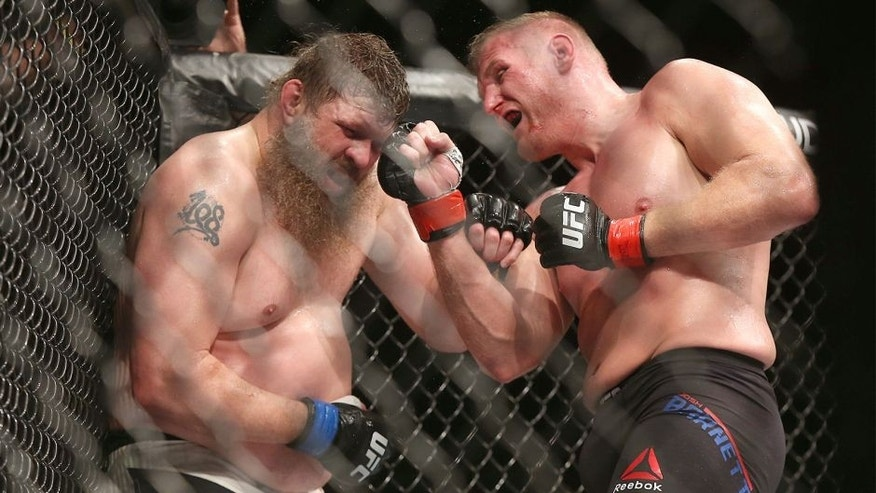 SAITAMA, JAPAN - SEPTEMBER 27: Josh Barnett of USA (R) throws a punch against Roy Nelson of USA in their heavyweight bought during UFC Fight Night at Saitama Super Arena on September 27, 2015 in Saitama, Japan. (Photo by Ken Ishii/Getty Images)