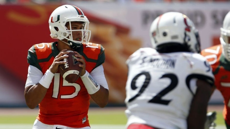 <p>Oct 11, 2014; Miami Gardens, FL, USA; Miami Hurricanes quarterback Brad Kaaya (15) drops back to pass in the first quarter of a game against the Cincinnati Bearcats at Sun Life Stadium. Mandatory Credit: Robert Mayer-USA TODAY Sports</p>