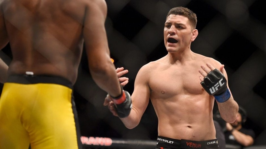 LAS VEGAS, NV - JANUARY 31: (R-L) Nick Diaz taunts Anderson Silva in their middleweight bout during the UFC 183 event at the MGM Grand Garden Arena on January 31, 2015 in Las Vegas, Nevada. (Photo by Jeff Bottari/Zuffa LLC/Zuffa LLC via Getty Images)