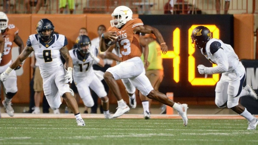 Sep 19, 2015; Austin, TX, USA; Texas Longhorns quarterback Jerrod Heard (13) carries the ball against the California Golden Bears during the second quarter at Darrell K Royal-Texas Memorial Stadium. Mandatory Credit: Brendan Maloney-USA TODAY Sports