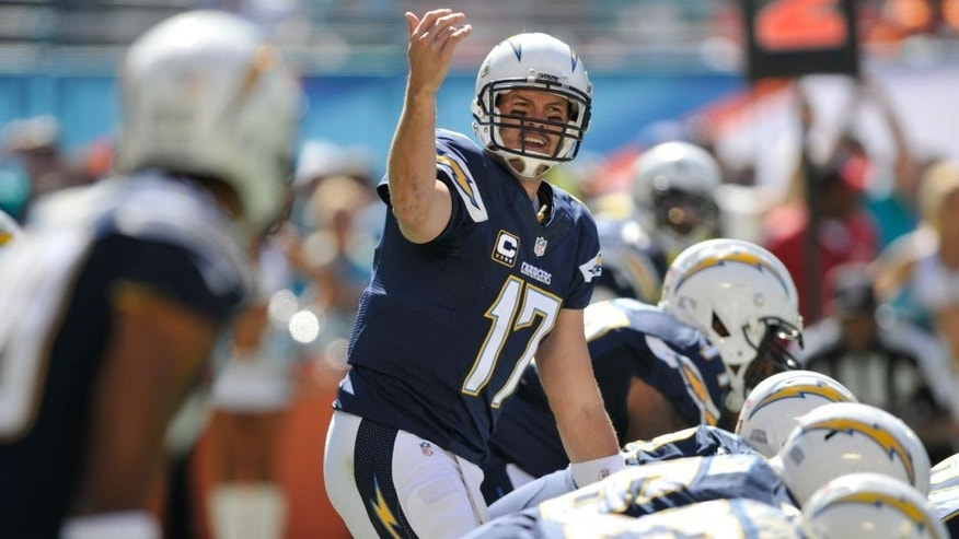 Nov 2, 2014; Miami Gardens, FL, USA; San Diego Chargers quarterback Philip Rivers (17) gestures from the field in the first quarter against the Miami Dolphins at Sun Life Stadium. Mandatory Credit: Brad Barr-USA TODAY Sports