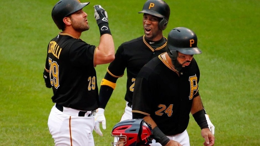 Pittsburgh Pirates' Francisco Cervelli, left, celebrates with teammates Andrew McCutchen, center, and Pedro Alvarez after hitting a grand slam off St. Louis Cardinals starting pitcher Michael Wacha in the fourth inning of a baseball game in Pittsburgh, Wednesday, Sept. 30, 2015. (AP Photo/Gene J. Puskar)
