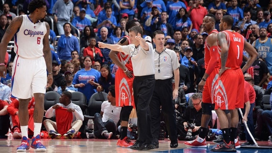 LOS ANGELES, CA - MAY 14: Referee Scott Foster signals for a replay in Game Six of the Western Conference Semifinals between the Los Angeles Clippers and the Houston Rockets during the 2015 NBA Playoffs on May 14, 2015 at Staples Center in Los Angeles, California. NOTE TO USER: User expressly acknowledges and agrees that, by downloading and or using this Photograph, user is consenting to the terms and conditions of the Getty Images License Agreement. Mandatory Copyright Notice: Copyright 2015 NBAE (Photo by Andrew D. Bernstein/NBAE via Getty Images)