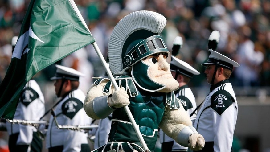 Sep 20, 2014; East Lansing, MI, USA; Michigan State Spartans mascot Sparty runs onto the field before the game against the Eastern Michigan Eagles at Spartan Stadium. Spartans beat the Eagles 73-14. Mandatory Credit: Raj Mehta-USA TODAY Sports