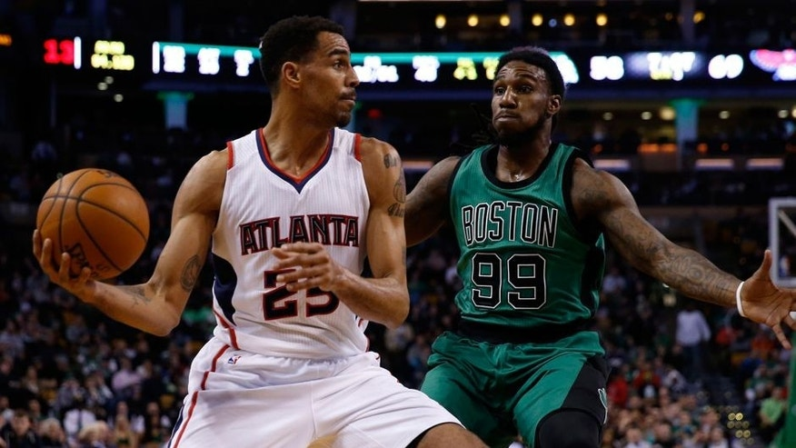 Jan 14, 2015; Boston, MA, USA; Atlanta Hawks guard forward Thabo Sefolosha (25) makes a pass while guarded by Boston Celtics forward Jae Crowder (99) during the third quarter at TD Garden. Mandatory Credit: Greg M. Cooper-USA TODAY Sports