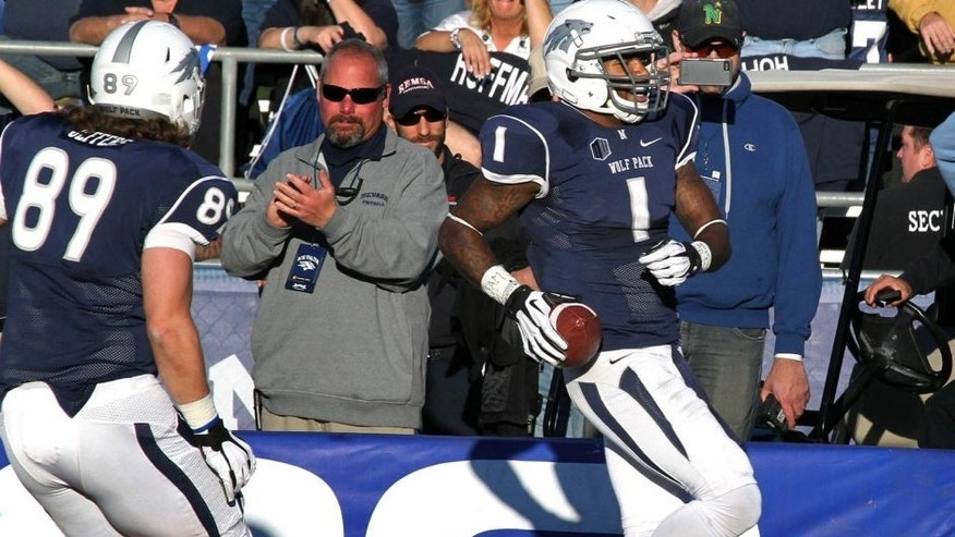 Nov 30, 2013; Reno, NV, USA; Nevada Wolf Pack wide receiver Brandon Wimberly (1) catches a second half touchdown pass against the BYU cougars in their NCAA football game at MacKay Stadium. Mandatory Credit: Lance Iversen-USA TODAY Sports. BYU won 28-23.