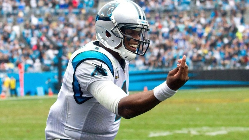 Sep 27, 2015; Charlotte, NC, USA; Carolina Panthers quarterback Cam Newton (1) takes a bow after a touchdown in the fourth quarter against the New Orleans Saints at Bank of America Stadium. Mandatory Credit: Jeremy Brevard-USA TODAY Sports